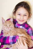 Smiling child and kitten — Stock Photo