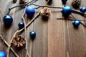Blue Christmas ornament balls with pine cones — Stock Photo