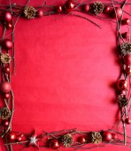 Red Christmas ornament balls with star on red background — Stock Photo