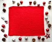 Christmas ornaments with red knitted fabric — Stock Photo