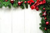 Red Christmas ornament balls with star on fir leaves.frame — 图库照片