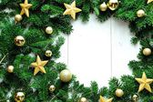 Gold star ornaments on fir leaves.frame — Foto Stock