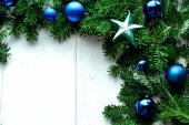 Blue Christmas ornament ball with star on fir leaves — Stock Photo