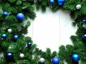 Blue and silver ornament balls on fir leaves.frame — Stock Photo