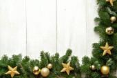 Gold star ornaments on fir leaves.frame — Stock fotografie