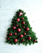 Red ornament balls with star Christmas tree — Foto de Stock