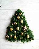 Gold star ornaments Christmas tree — Foto de Stock