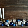 Blue and silver Christmas ornament balls with candles — Stock Photo #59134183