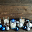 Blue and silver Christmas ornament balls with candles — Stock Photo #59134215