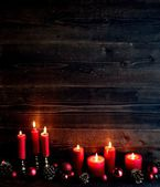 Red candles and Christmas ornament balls — Стоковое фото