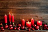 Red candles and Christmas ornament balls — Stock Photo
