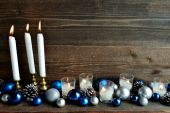 Blue and silver Christmas ornament balls with candles — Stock Photo