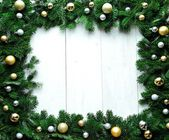 Gold and silver Christmas ornament balls on fir leaves — Foto de Stock