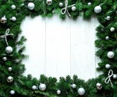 Silver Christmas ornament balls on fir leaves — Stock Photo