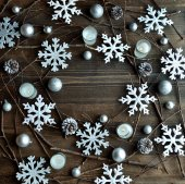 Silver and white snow flakes with candles — Stock Photo