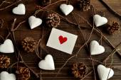 Red heart message card with white heart ornaments — Stok fotoğraf