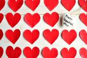 White heart Valentines day message ornament on red heart paper cut out background — Foto Stock