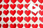 Red heart message card on red heart paper cut out background — Foto Stock