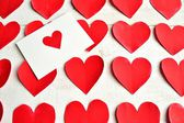 Red heart message card on red heart paper cut out background — Stock Photo