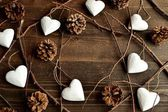 White heart ornaments with pine cones — Stock Photo