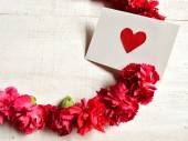 Red carnations with message card — Stock Photo