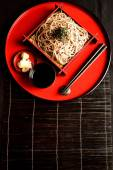 Chilled soba noodles on red tray — Stock Photo
