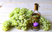 Grapes and candle. — Stock Photo