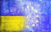 Political relations European Union Ukrainian flag  grunge  vintage retro style. — Stock Photo