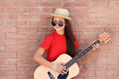 Beautiful  little  girl guitar. — Stock Photo