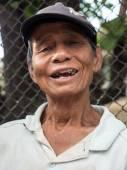 Old man celebrates Songkran festival — Stock Photo