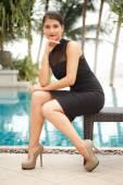 Russian model posing near pool — Stock Photo