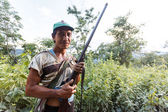 Local hunter with gun in Myanmar — Stock Photo