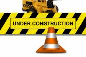 Under construction signboard with traffic cone — Stok fotoğraf