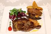 Macro scene of Pork meat with potatoes and salad — Stock Photo