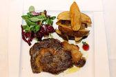 Pork steak with herbs and tomato — Stock Photo