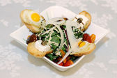 Fresh salad with toast and quail eggs — Stock Photo