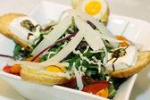 Closeup scene with mediterranean salad on white plate — Stock Photo