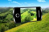 Smart phone and rural landscape — Stock Photo