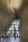 Futuristic entrance hall in Museum of History of Polish Jews in Warsaw. — Stock Photo