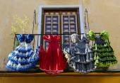 Traditional flamenco dresses at a house in Malaga, Andalusia, Sp — Stock Photo