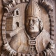 Wooden engraving of a bishop at the main door of Tui Cathedral, — Stock Photo #63711393