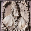 Wooden engraving of a bishop at the main door of Tui Cathedral, — Stock Photo #63711411