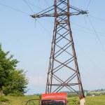 Постер, плакат: Car wreck and electricity pylon in Georgia