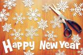 New Year background with various snowflakes on wooden surface — Fotografia Stock