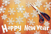New Year background with various snowflakes on wooden surface — 图库照片