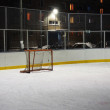 Empty hockey gate on an ice rink in the evening — Stock Photo #61275611