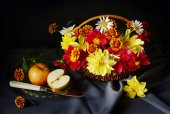 Still life with a cut apple and beautiful flowers into the basket — Stock Photo