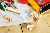 Various working tools lie on the wooden workbench — Stock Photo