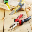 Pliers and a cutter lie on the workbench — Stock Photo #63547789