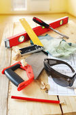 Composition with carpenter work tools on the wooden workbench — Stock Photo